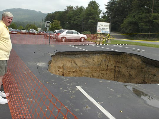 A sinkhole opened up in the parking lot of the Asheville AAA office on Merrimon Avenue