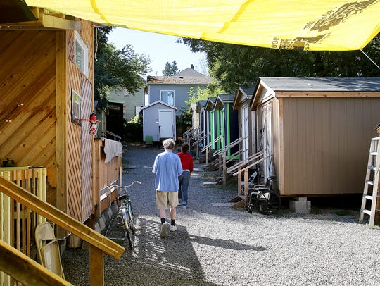 Seattle's Tiny Home Village has shared bathroom and kitchen facilities. The village has its own leadership, and residents police their own.