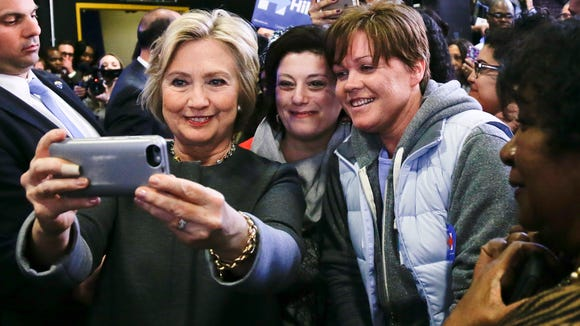 Hillary Clinton takes a selfie with supporters during