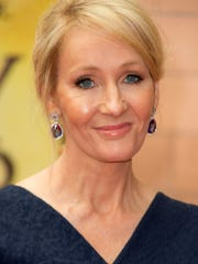 Writer J.K. Rowling poses for photographers upon arrival