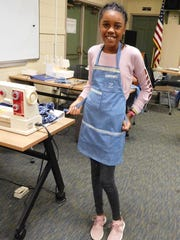 Zadiyah Ash shows off the apron she made during the