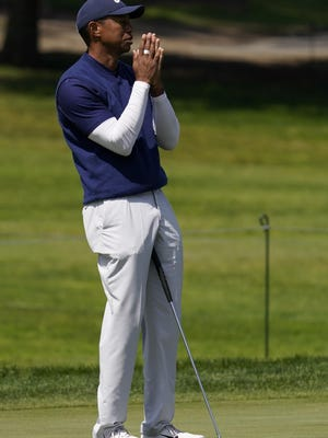 Tiger Woods reacts after missing a putt on the seventh hole during the third round of the PGA Championship at TPC Harding Park in San Francisco on Saturday.