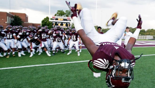 Zack Dobson does a back flip before their game against Maryville Saturday, Aug. 27, 2016 at Fulton High School. Dobson signed with MTSU on Wednesday and will wear No. 24 to honor his late brother, Zaevion.