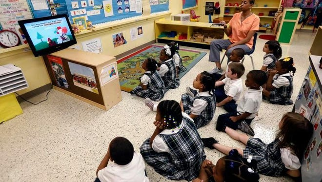 """Preschoolers at the Agape Educational Center in Canton, Miss., learn words that start with """"R"""" and concepts like opposites from """"Between the Lions,"""" a TV show that was produced at Mississippi Public Broadcasting."""