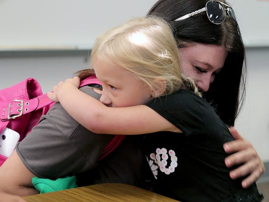 Lilly Benedict, a 5-year-old incoming kindergartner at Olalla Elementary, hugs her mom, Anna Stacy, as she is dropped off at the school for their kindergarten boot camp.