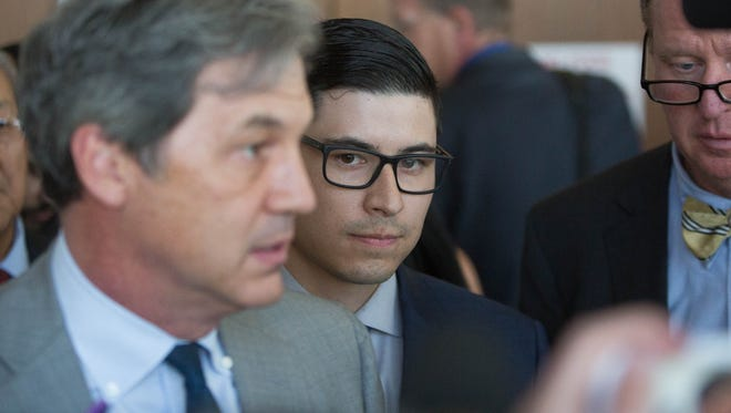 Tai Chan, center, stands quietly as his attorney John Day speaks with media gathered outside the 3rd Judicial District Courtroom where a judge declared a mistrial after a jury could not come to a decision. Tuesday May 23, 2017.