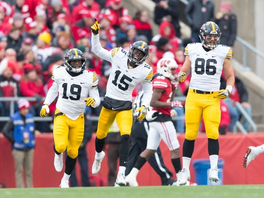 Iowa Hawkeyes defensive back Joshua Jackson (15) celebrates