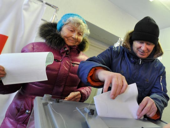 People cast their ballots at a polling station in Yelizovo,