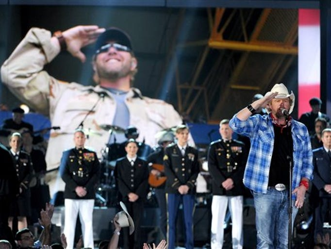 Toby Keith performs at ACM Presents an All-Star Salute to the Troops on Monday, April 7, 2014, in Las Vegas.