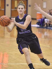 Mifflin County's Jess Wright (13) recieves a pass from