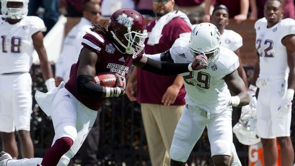 Mississippi State Bulldogs wide receiver De'Runnya Wilson (1) pushes away Texas A&M Aggies defensive back Deshazor Everett (29) at Davis Wade Stadium.