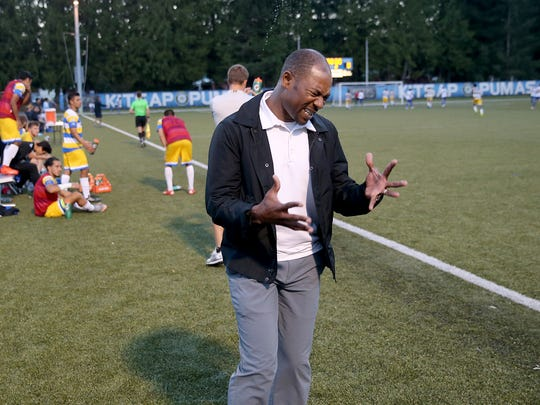 Kitsap Pumas coach Roy Lassiter reacts to a missed opportunity during a game against FCM Portland at Gordon Field.