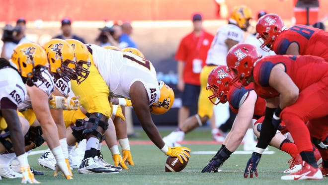 ASU offensive lineman Stephon McCray (77) prepares to snap the ball against the Arizona Wildcats during the 88th annual territorial cup at Arizona Stadium.