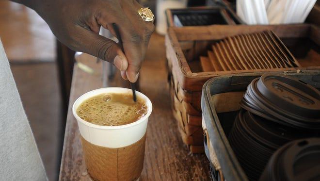 Julius Badigo has coffee at Black Sheep Coffee in Sioux Falls, S.D. Tuesday, June 26, 2012. (Emily Spartz / Argus Leader)