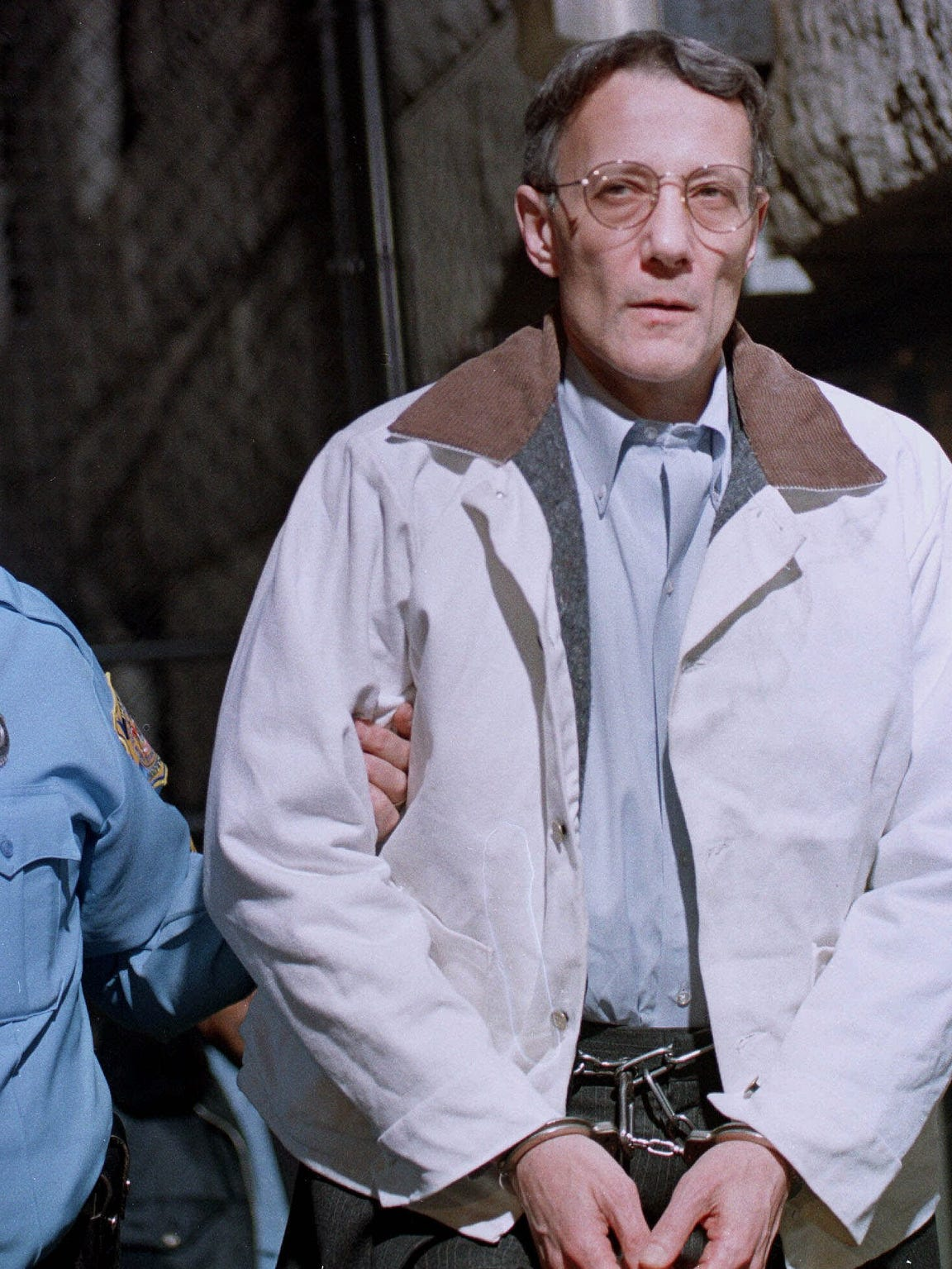 Thomas Capano, right, is escorted from a courthouse