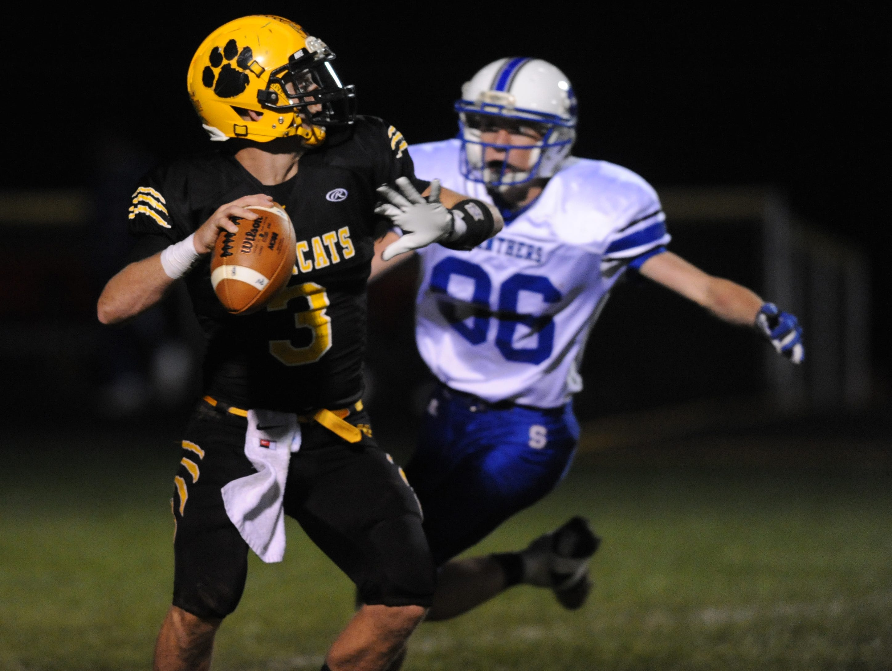 Paint Valley's Anthony McFadden reaches back to throw the ball before Southeastern's Zach Bodary reaches him Friday, Oct. 9, 2015, at Paint Valley High School.