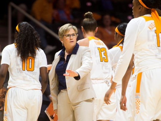 Tennessee head coach Holly Warlick high fives her players during a timeout during Tennessee's exhibition opener against Carson-Newman at Thompson-Boling Arena on Tuesday, Nov. 7, 2017.