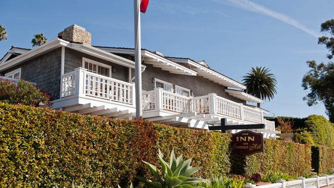 Inn on Summer Hill, Santa Barbara: Inn on Summer Hill is a charming beachside bed-and-breakfast located in the coastal village of Summerland. From the outside, the inn resembles a typical beach home with Shaker siding and white decks overlooking the Pacific Ocean. The interior is more country than beachy, with wood-paneled walls or ceilings and wood-burning fireplaces and whirlpool tubs in each room. Rooms, which are decorated in a homey style, also have balconies that offer ocean views -- though the Pacific lies just beyond busy Route 101.