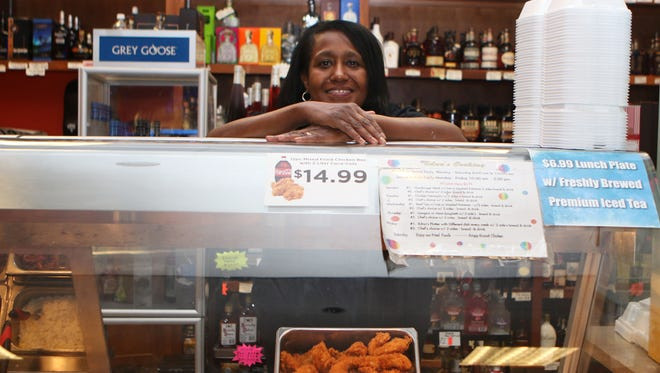 Edna White stands behind the deli counter she leases and operates in Tiger Market, located at 18th Street and Forsythe Avenue in Monroe. She serves grits, fried chicken, beef tips, lasagna and other meals.