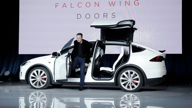 Elon Musk, CEO of Tesla Motors Inc., introduces the Model X SUV near the  company's factory in Fremont, Calif.