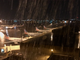 A torrent of rain from a monsoon storm pours onto airplanes
