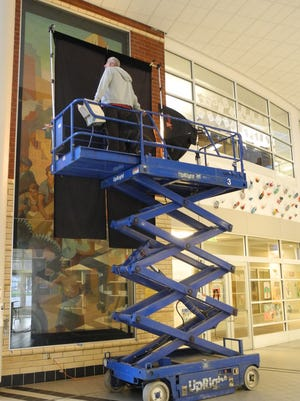 This undated photo shows a lift operator positioning the camera unit in front of one of the Carl W. Peters murals at the Wilson Foundation Academy in Rochester. Carl W. Peters' 1937 paintings Life of Action and Life of Contemplation, are showcased in the new film Enough to Live On: The Arts of the WPA.