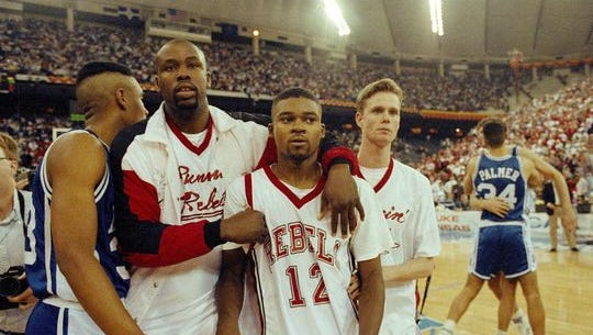 UNLV's Anderson Hunt (12) and unidentified teammates leave the floor after losing to Duke in the NCAA national semi-final game in Indianapolis, March 30, 1991. Duke defeated UNLV.