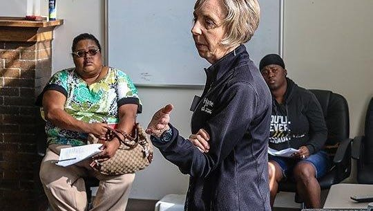Employment coach Jan Hise counsels clients on job readiness at the Hawthorne Community Center in Indianapolis. The center is one of 20 non-profit organizations to receive a grand from the Nina Mason Pulliam Charitable Trust.