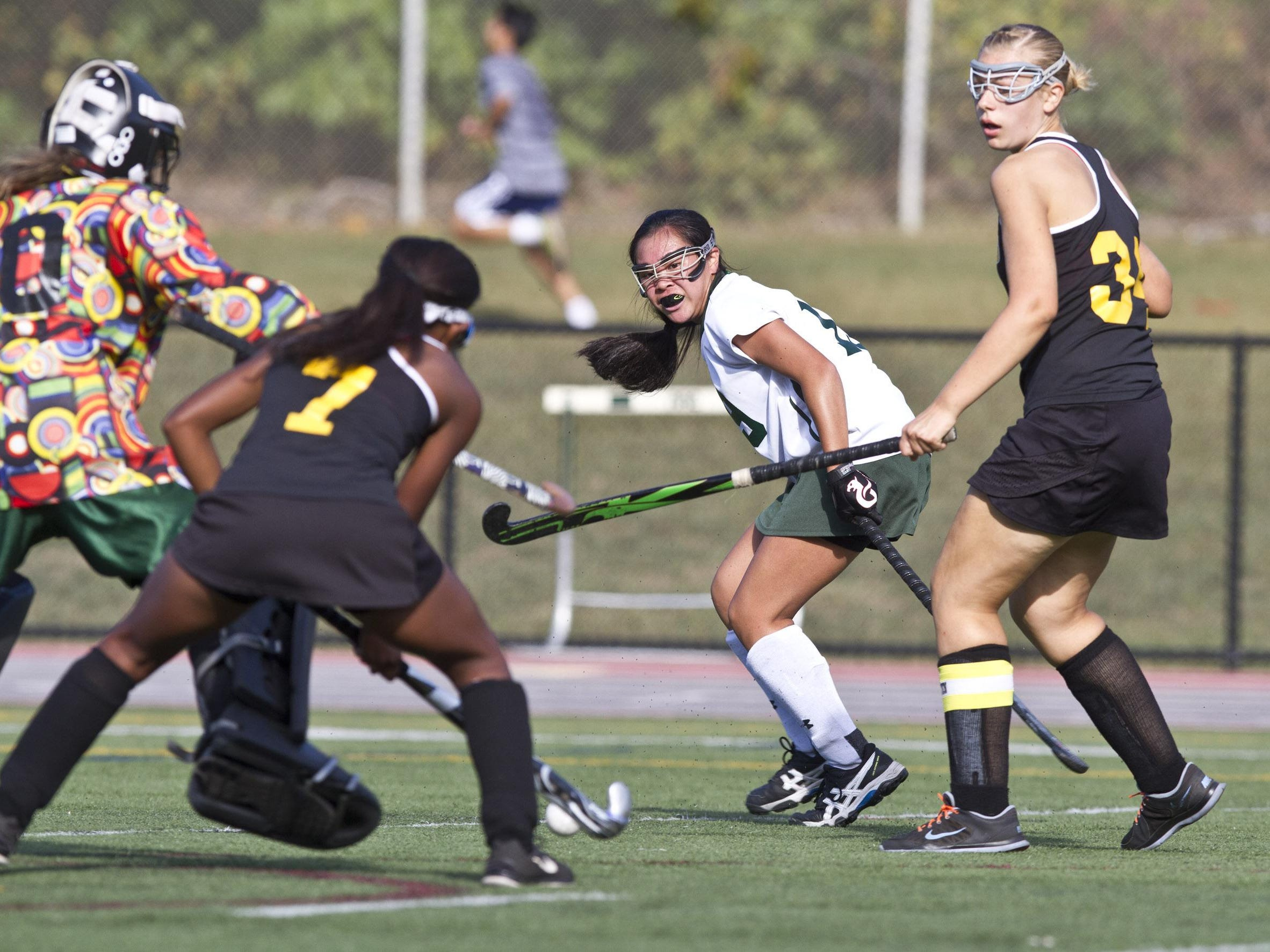 East Brunswick's Sydney Huang looks at her shot on goal being blocked by goal keep Nadya Khan and Dominique Nelson (7). Piscataway vs East Brunswick field hockey. 72670492 East Brunswick, NJ Thursday, September 24, 2015 @dhoodhood