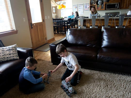 Ryan Nelson and Jonah Greenwell play with Legos as Lauren Greenwell and Emery Nelson color after school at the Greenwell's home in Park City on Friday, March 16, 2018. Andrea Greenwell watches from the kitchen.
