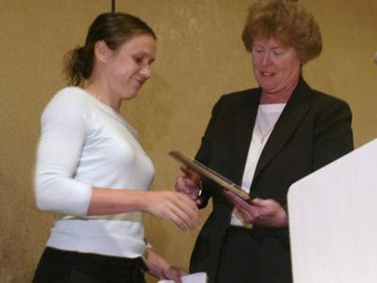 On June 6, 2005 Olympian and East Brunswick native Heather O'Reilly accepts a plaque from Elaine McGrath for having been the guest speaker at this year's GMC Scholar-Athlete awards dinner at the Pines Manor.