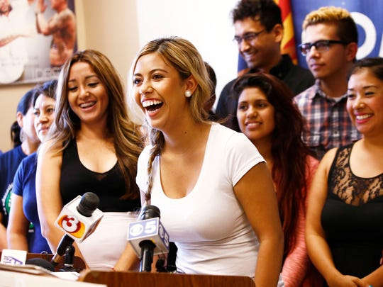 Korina Iribe Romo, age 24, celebrates with other Arizona DREAMers at a press conference on Monday, July 7, 2014 in Phoenix, AZ. An appeals court blocked Arizona Gov. Jan Brewer's policy of denying driver's licenses to young immigrants who have gotten work permits and avoided deportation under an Obama administration policy. The ruling Monday by the 9th U.S. Circuit Court of Appeals marks a victory for immigrant rights advocates who argued the young immigrants were harmed by unequal treatment by the state. The appeals court agreed on that issue and said the advocates also showed a likelihood that the immigrants would be harmed by the state's denial.