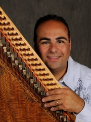 Ara Topouzian with traditional 76-string musical instrument,