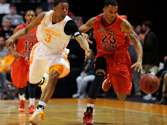 FILE - In this Nov. 7, 2013, file photo, Tennessee guard Robert Hubbs, left, defends against Southern Indiana's Alex Marzette during a NCAA college basketball game in Knoxville, Tenn. Hubbs decided to stay at Tennessee after speaking to new coach Donnie Tyndall, who took over the program after California hired away Cuonzo Martin. (AP Photo/Knoxville News Sentinel, Adam Lau)