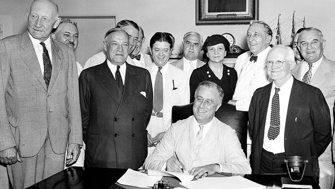 President Franklin Roosevelt signs the Social Security Bill in Washington, D.C., on Aug. 14, 1935.