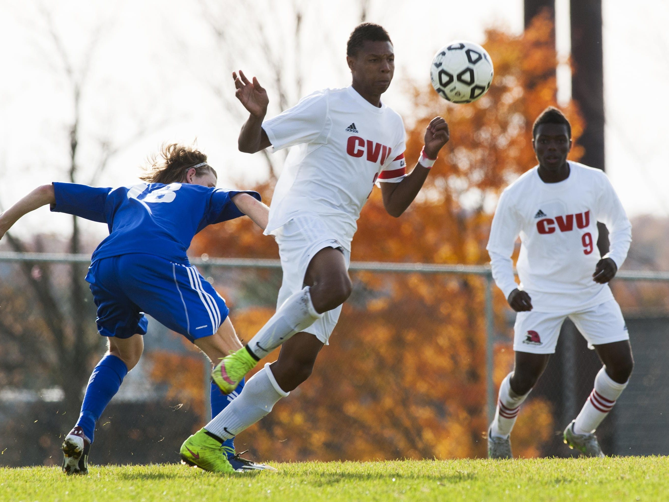 CVU's Trey Tomasi (25) plays the ball during a high school boys soccer semifinal against Mount Anthony earlier last week.
