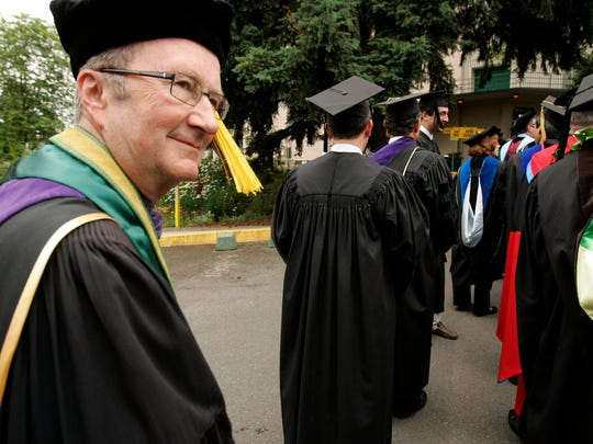 "In this Saturday, June 13, 2009 photo, University of Oregon President Dave Frohnmayer walks last, according to tradition, in the procession entering McArthur Court where he presided over his final commencement as president of the university. The widely respected leader in Oregon politics and academics, died Monday, March 9, 2015 at 74. A statement from his family says Frohnmayer died after ""a quiet battle"" for five years against prostate cancer."