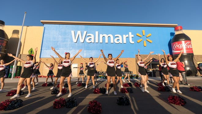 Cheerleaders from Cortez High School in Phoenix perform at the grand opening of the Walmart at Metrocenter on Oct. 11, 2017.