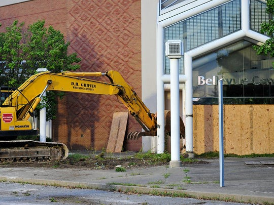 An entrance of Bellevue Center is demolished in Bellevue on Saturday, Aug. 22, 2015. This is the first step to making One Bellevue Place on the property.