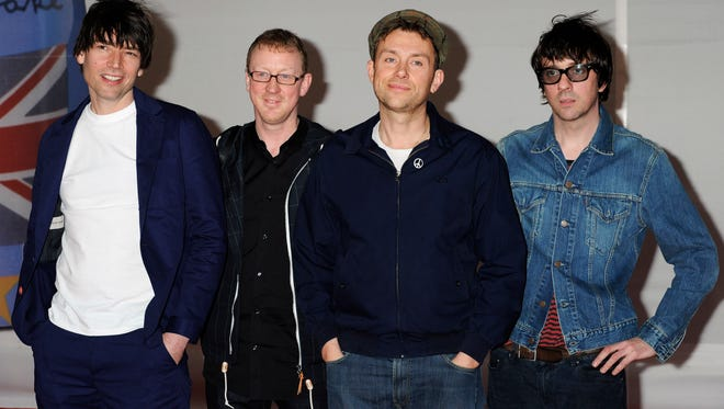 From left, Alex James, Dave Rowntree, Damon Albarn, Graham Coxon, of Blur arrive for the Brit Awards 2012 at the O2 Arena in London on Feb. 21, 2012.