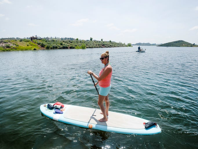 Angie Shireman sets out on her paddleboard in Horsetooth Reservoir Thursday, July 17, 2014. Shireman said she took up paddleboarding after a recent brain surgery kept her from practicing yoga. She now says she comes to paddleboard in Horsetooth Reservoir nearly every day.