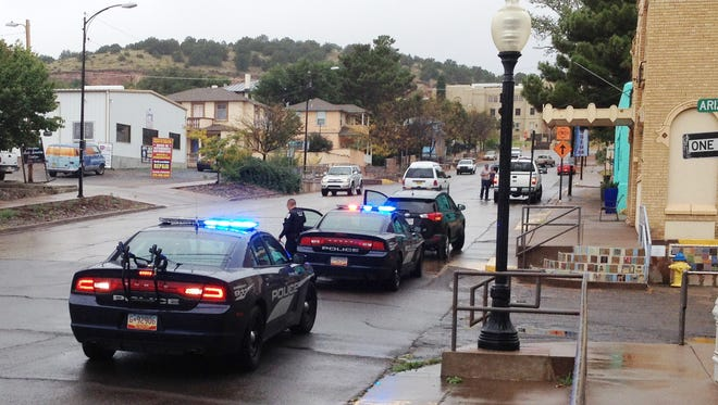 Silver City Police Officers respond to a fender-bender on Broadway Street on Monday morning.