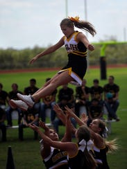 Santa Anna High School cheerleaders perform during