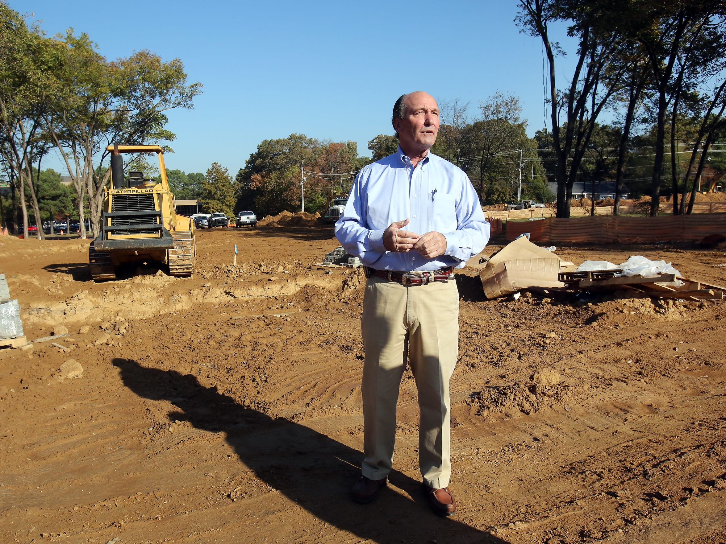 Ray Gill stands in the midst of construction on the TraVure site at Poplar and Kirby Parkway . The development is in the early stages and is a sign of the changing face of Germantown.