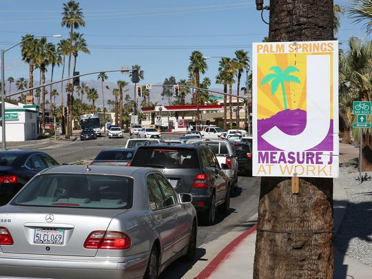 "Traffic drives by a ""Measure J"" sign on Palm Canyon Dr. in Palm Springs, February 13, 2017."