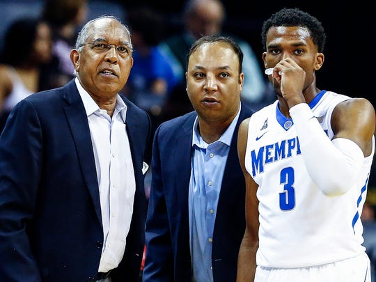 University of Memphis head coach Tubby Smith (left) and assistant coach Saul Smith (middle) chat with guard Jeremiah Martin (right) during a break in against LeMoyne-Owen at the FedExForum in Memphis, Tenn., Thursday, November 2, 2017.