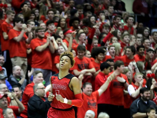 The crowd cheers on New Albany's Romeo Langford after