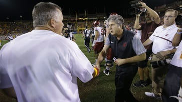 ASU head coach Todd Graham gives an earful to Washington State head coach Mike Leach during their postgame greeting on Saturday, Oct. 22, 2016 in Tempe, Ariz.