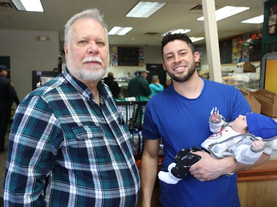 Frequent customer Mike Adamovich and co-owner Greg Scavelli with son Greg III, at JV Hot Bagels II in Shrub Oak, March 6, 2018.