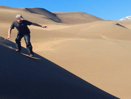 635987553846482992-Man-Sandboarding-credit-NPS-Joseph-Tumidalsky.jpg